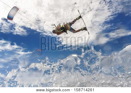 Kite Surfer Riding Wave