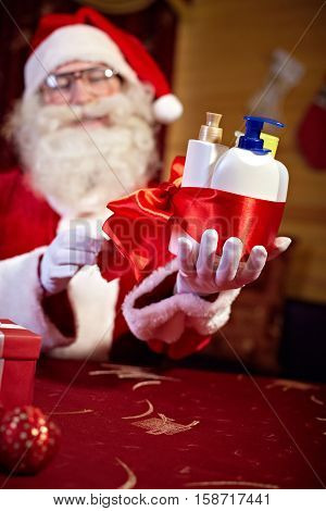 Santa Claus wrapping cosmetic products for women