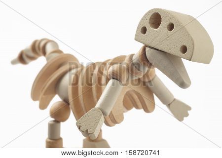 Dinosaur wooden articulated toy isolated on white. Horizontal