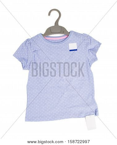 Blue dotted cotton t-shirt on black plastic hanger. Isolated on a white background.