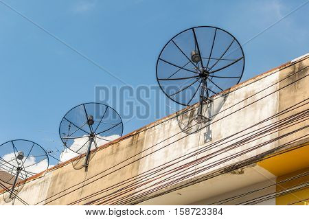 Antenna communication satellite dish with sky background