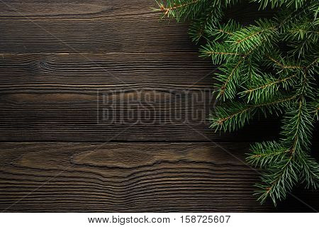 Christmas wooden background with fir tree. Wooden background. Christmas Wreath with Rustic Wood Background. Christmas design - Merry Christmas. Christmas ornaments