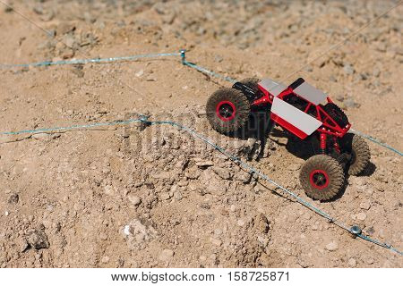 Rc toy suv roading rally off road track, free space. Small crawler rising on mountain landscape. Race, hobby, extreme, entertainment, competitions concept