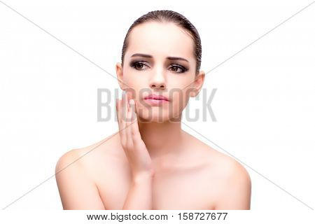 Woman with toothache isolated on white