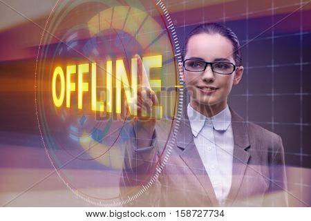 Businesswoman pressing virtual button offline
