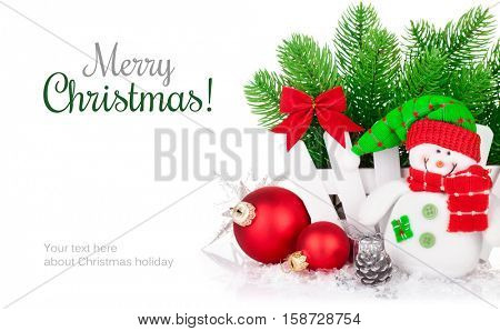 Christmas greeting card with snowman branch firtree red balls pinecone bow and copyspace. For new year decoration white wooden basket. Isolated on background