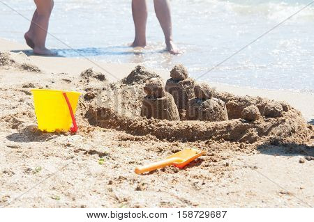 sand figure constant children on the seashore in clear summer day