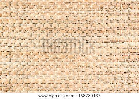 Bamboo woven beige mat handmade background. Wicker wood texture. Horisontal strips.