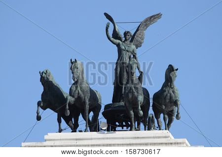 Statue of Victory driving the quadriga on top of Victor Emmanuel II monument in Rome, Italy