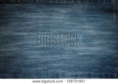 close up background and Texture of dark blue jeans