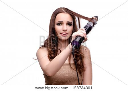 Beautiful woman getting her hair done with hair dryer isolated o