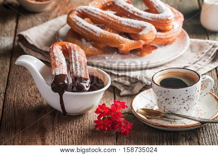 churros, coffee and hot chocolate on wooden table
