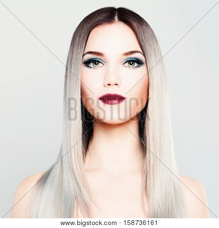 Stylish Woman Fashion Model with Makeup and Gradient Coloring Hairstyle. Platinum Blonde Silky Hair