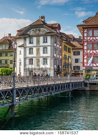 Lucerne Switzerland - May 24 2016: Architecture of Lucerne. Scenery of Rathaussteg Bridge over Reuss River in Old Town Lucerne Switzerland.