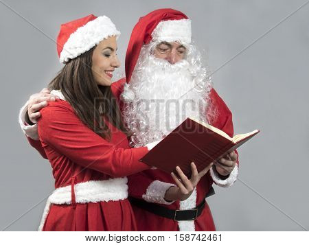 Santa claus and deputy reading wish book