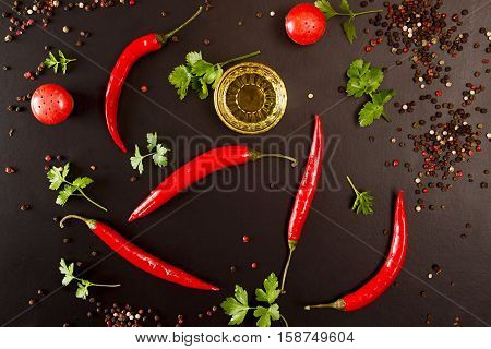 Red Chili Pepper On Black Background. Composition Of Group Chili Peppers.