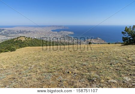 A view of the Crimean coast from the top of the mountain. The surroundings of the resort town of Sudak. September.