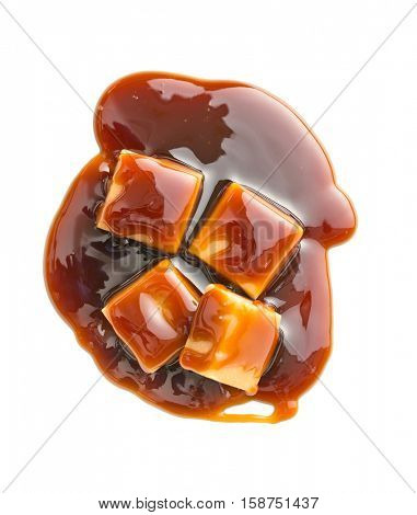 Caramel candies with caramel sauce isolated on white background.