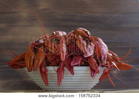 Plate Of Boiled Red Crayfishes On Wooden Background