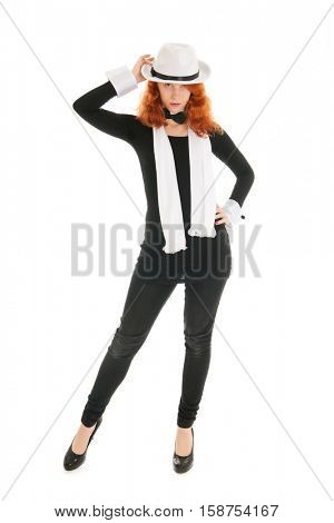Woman as dandy with hat. shawl and high heels isolated over white background