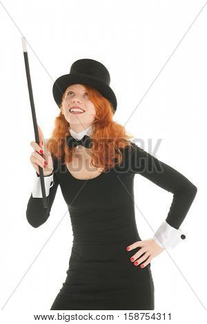 Woman as dandy with black hat pointing up with stick isolated over white background