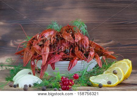 Red Crayfishes, Fennel, Onions, Lemon, Tomato, Peppers On Wooden Background