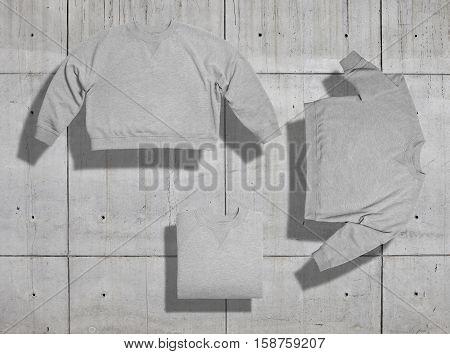 Set of three shots of light heather gray blank short womens sweatshirt arranged in different ways on industrial background for merchandise presentation