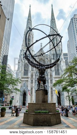 NEW YORK,USA - AUGUST 19,2016 : The Atlas Statue at the Rockefeller Center and  Saint Patrick's Cathedral at New York's Fifth Avenue