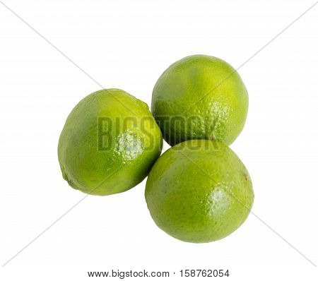 Closeup of fresh limes. Isolated on a white background.