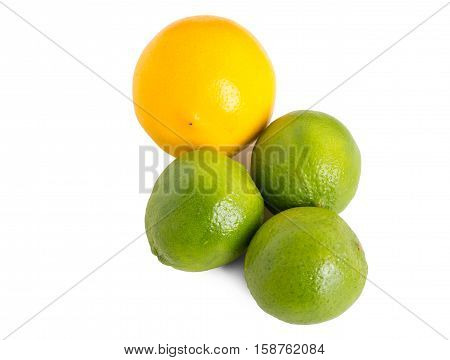 Closeup of fresh limes and orange. Isolated on a white background.