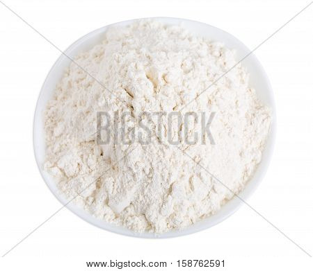Wheat flour in ceramic bowl. Isolated on a white background.