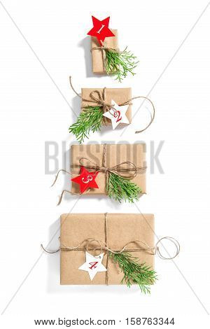 Christmas tree Advent calendar. Wrapped gift boxes. Holidays presents. Flat lay background