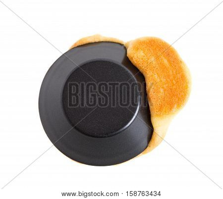 Closeup of black form with melted cupcake. Macro. Isolated on a white background.