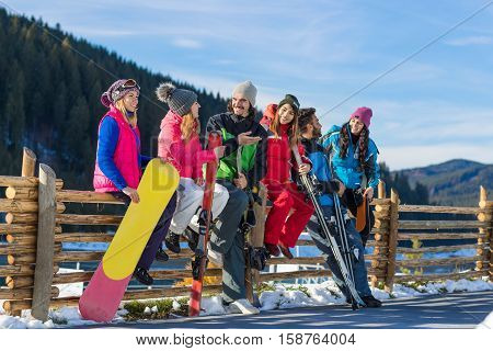 People Group With Snowboard Ski Resort Snow Winter Mountain Cheerful Friends Sitting On Wooden Hence Talking Extreme Sport Vacation