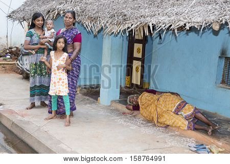 Illustrative image. Pondichery, Tamil Nadu, India. April 14, 2014. Child with mother in the street of village