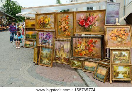 VITEBSK BELARUS - JULY 13 2016: Unidentified people visit outdoor exhibition and sale of paintings at Slavic Bazaar in Vitebsk