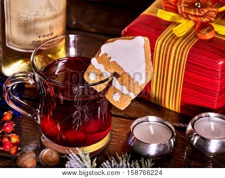 Warming mulled wine drink with bottle of red wine . Label on bottle of wine and gift box. Warming mulled wine with cookie in form of house .