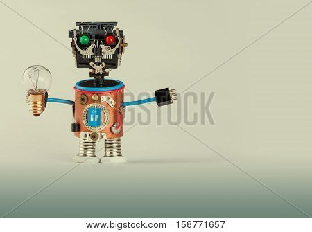 Retro style robot with light bulb. Plastic head colored green red eyes electric wire hands gears cog wheel and clock part mechanism. Fun toy character concept. Gradient background macro
