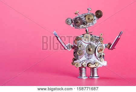 Steampunk service robot concept. Repair man with screw drivers. Aged gears cog wheel hand clock parts mechanism. Shabby scratch metal texture. Pink background shallow depth of field