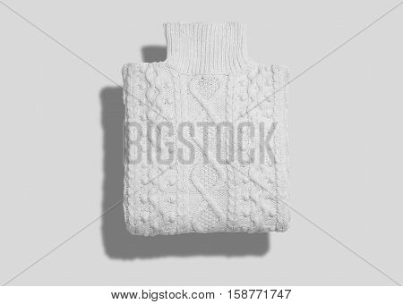 Turtleneck cotton cableknit white warm sweater neatly folded isolated on white