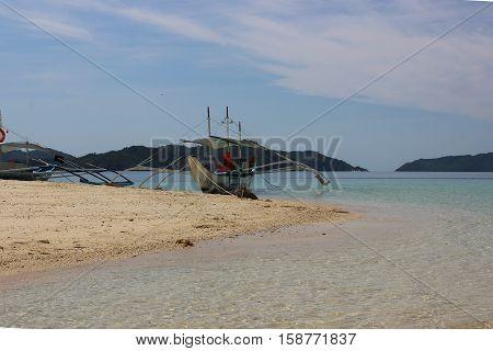 Traditional filippino boat in the sea, Port Barton, Philippines