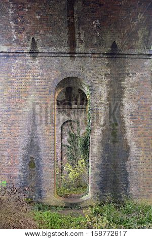 Under the Arches at Capel's Mill Railway Viaduct over the River Frome & Thames & Severn Canal Stroud Gloucestershire