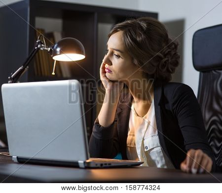 Portrait of a  businesswoman sitting at her workplace in office