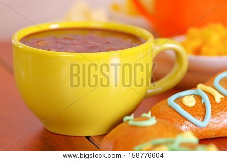 Yellow bowl with traditional tasty latin american colada morada berry juice, symbolizing blood from those deceased, day of the dead concept.