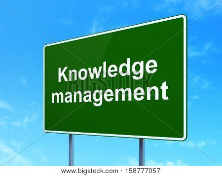 Learning concept: Knowledge Management on green road highway sign, clear blue sky background, 3D rendering
