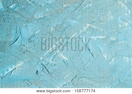 Abstract textured background: mixture of blue gray and white putty. Uneven strokes rough texture of a wall pattern