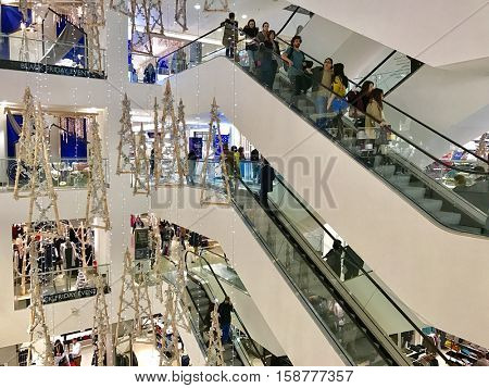 LONDON - NOVEMBER 27: People on escalators at John Lewis Department Store Oxford Street during Black Friday weekend on November 27, 2016 in London, UK.