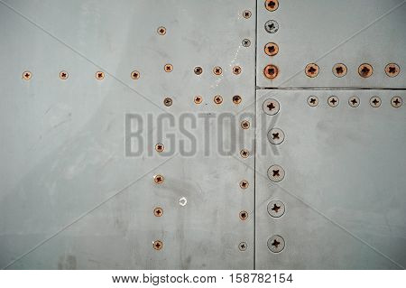 Dirty detailed for background to rust airplane rivets