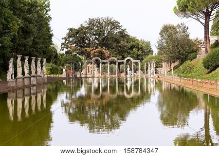 Statue with reflection at the hadrian villa, adriana is a large roman archaeological complex at tivoli, Italy