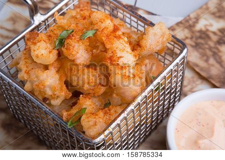 Fresh fried yellow squid with white sauce